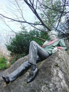 Wilde reclining on the 35 tonne block of vein quartz the sculptor hand picked in Ireland's Wicklow Mountains.